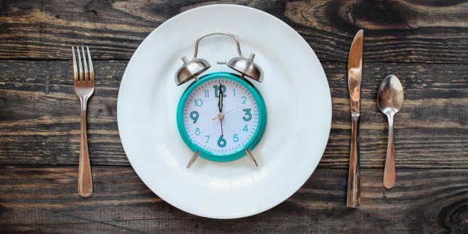 a clock on a dinner plate